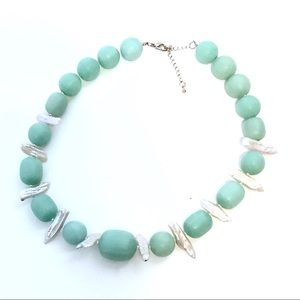 Sea Green with mother of pearl necklace.